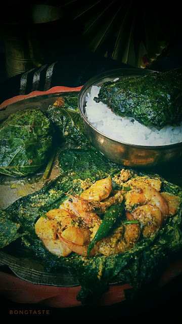 Lau Patae Chingri Paturi (Prawns Cooked in Bottle gourd leaf)
