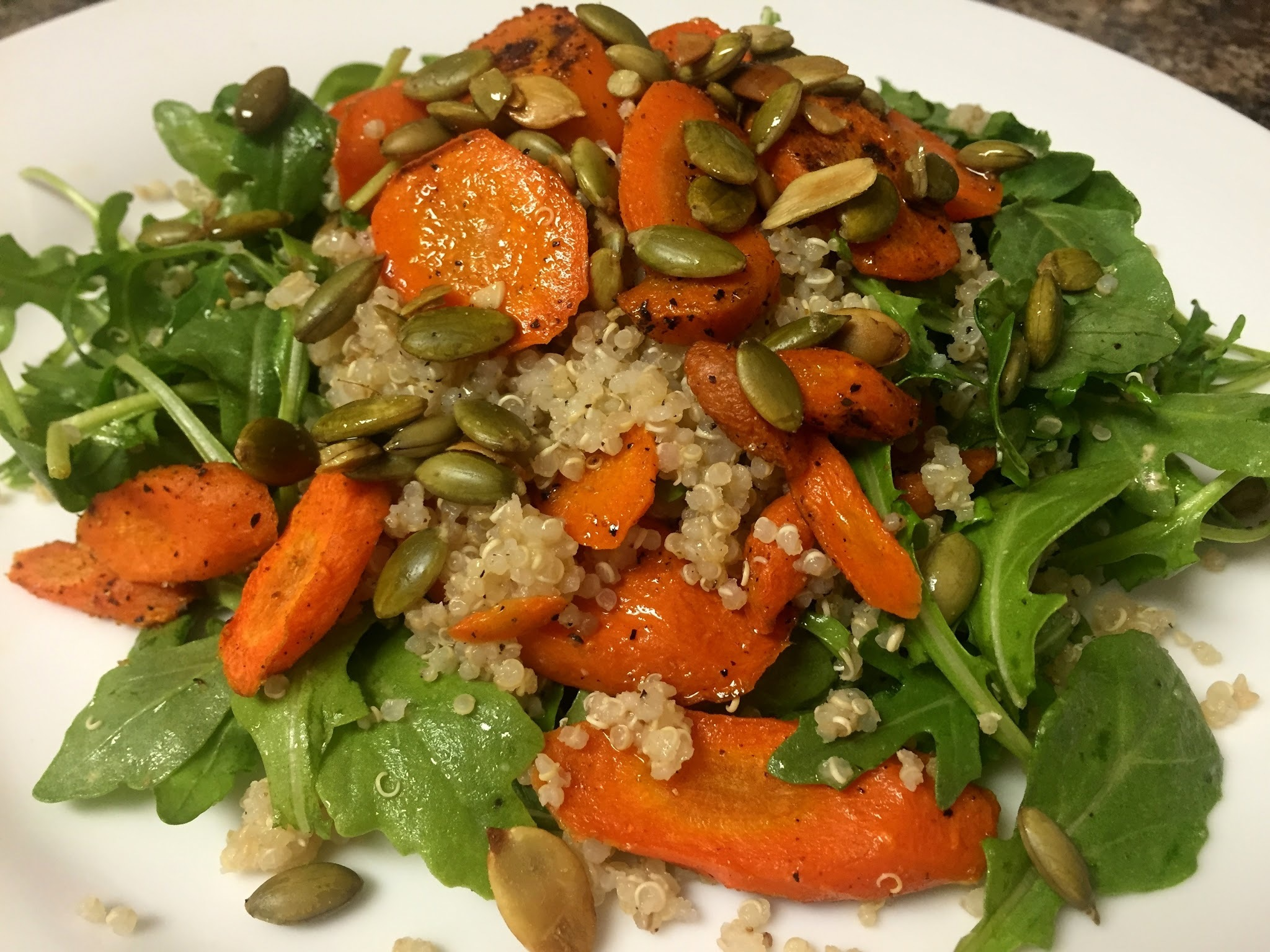 Spice Roasted Carrot Salad with Arugula, Quinoa, Pumpkin Seeds, and Lime Vinaigrette