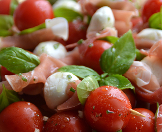Cherry tomatoes, mozzarella and parma ham skewer snacks