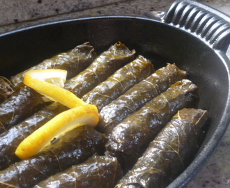 Summer fruit and preserved grape leaves