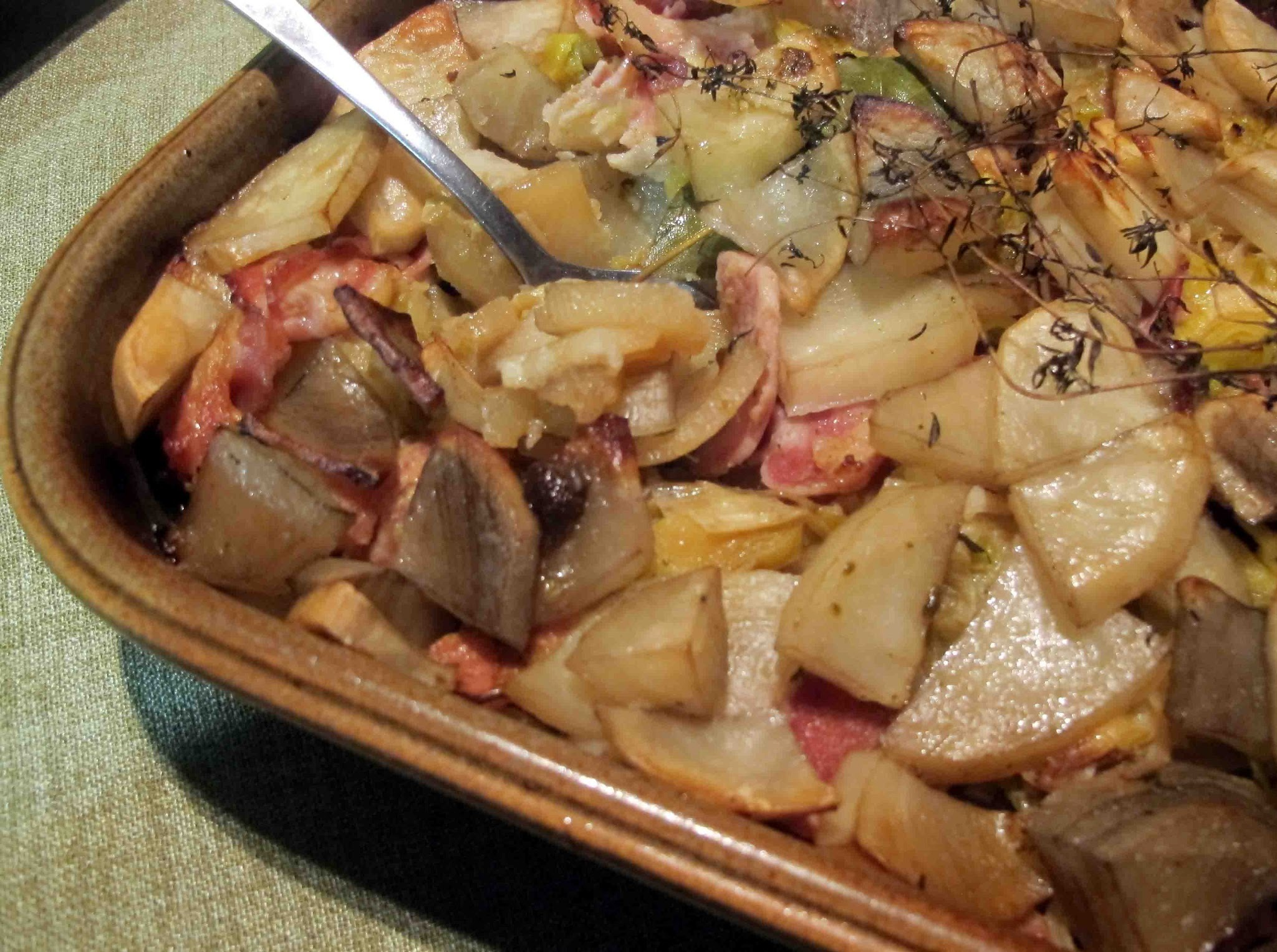 Potatoes baked with leeks, bacon and fresh garden herbs.