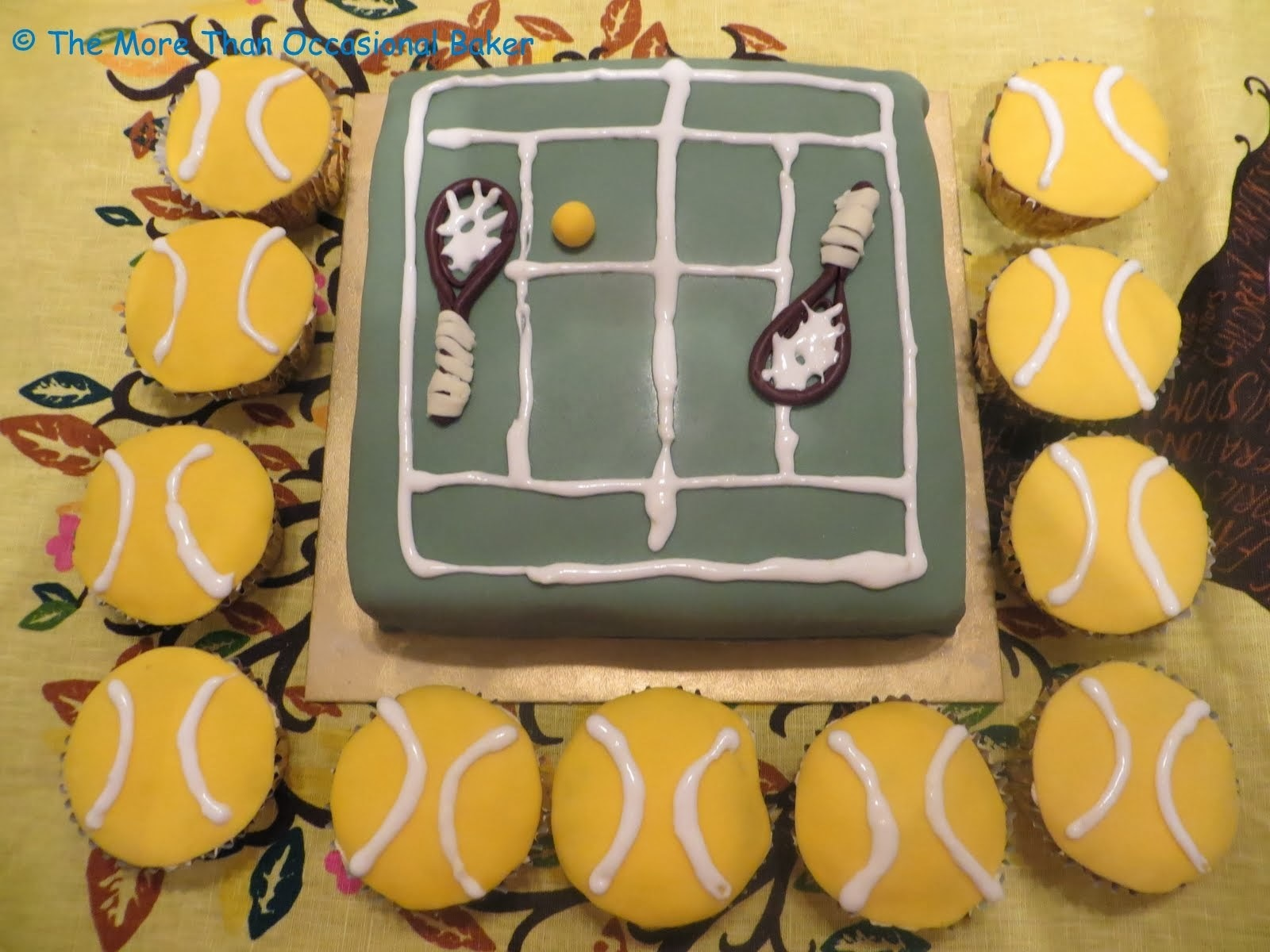 Tennis themed cake and cupcakes