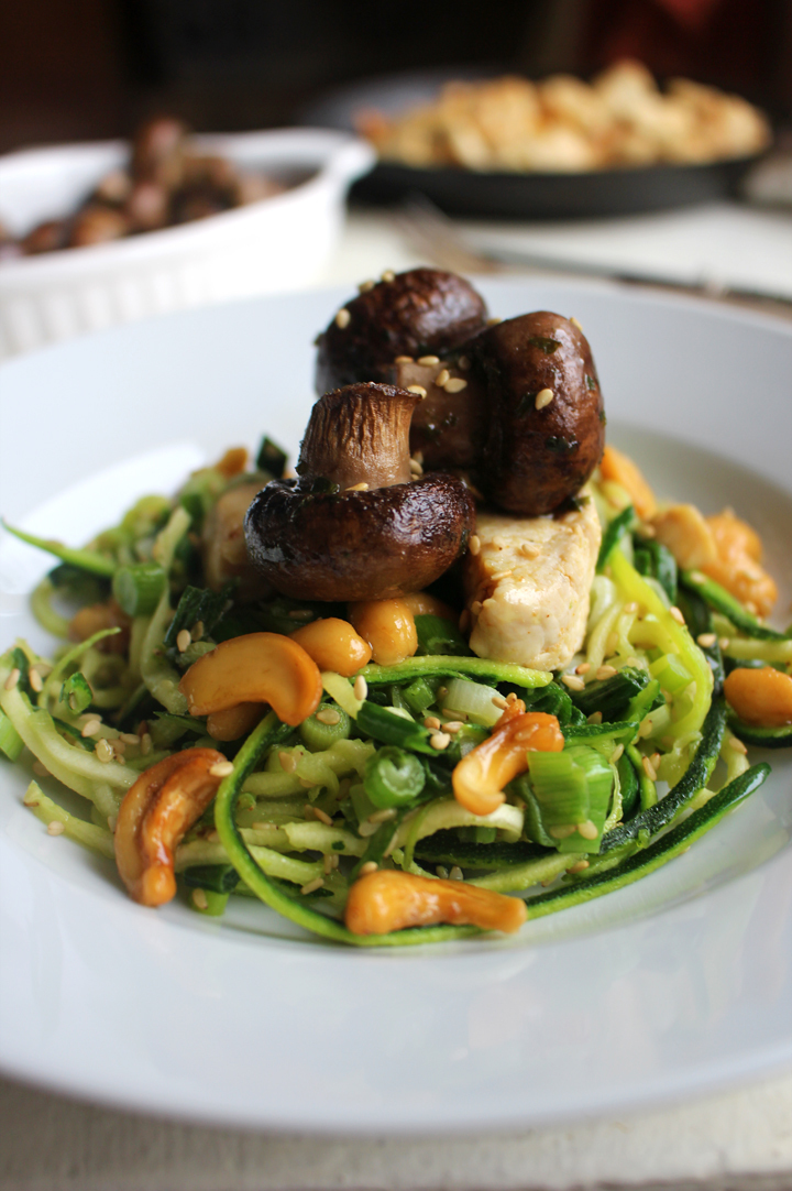 Sesame sprinkled courgetti with Irish parsley & butter roasted chestnut mushrooms, chicken, spring onion and cashew nuts