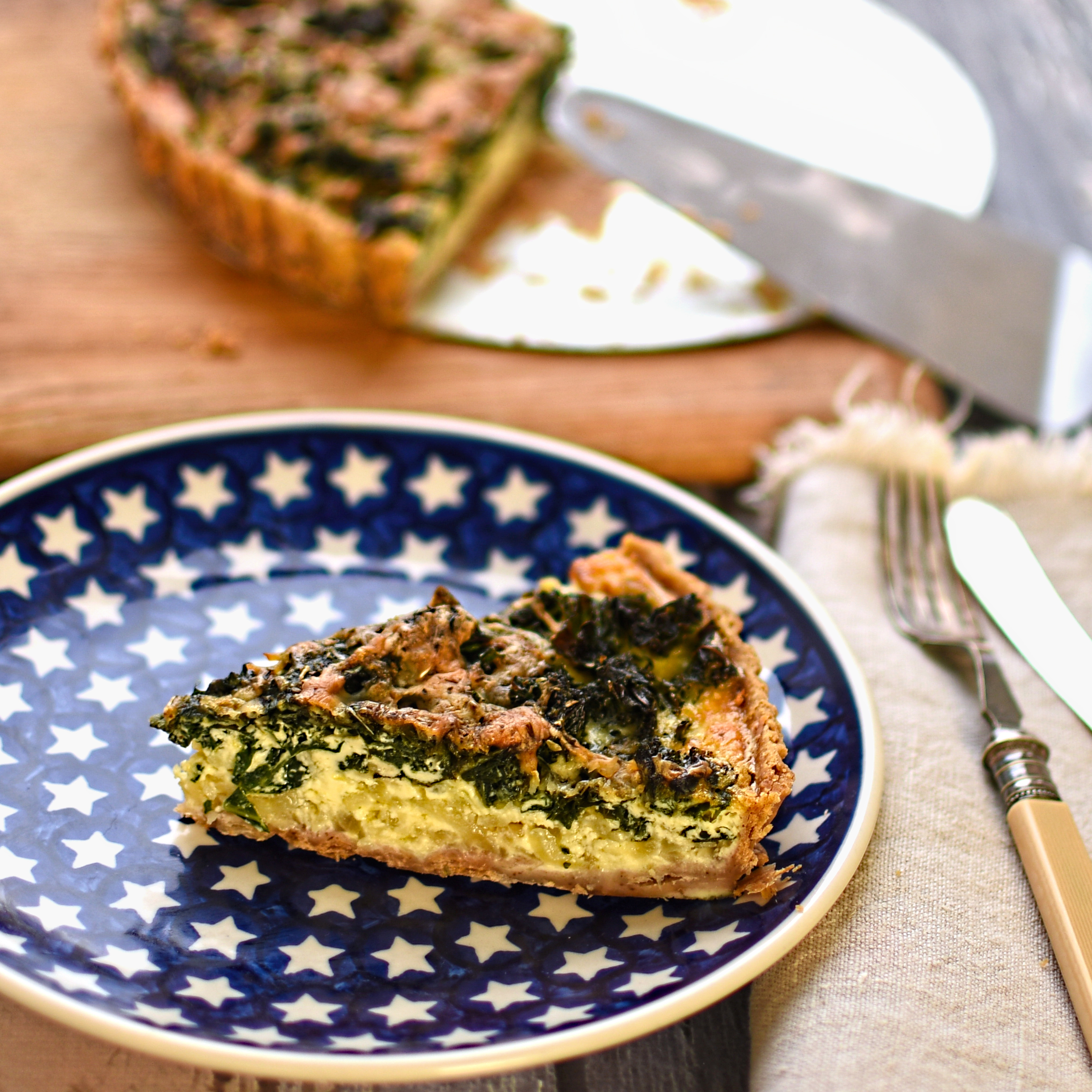 kale and caramelised onion tart with walnut crust