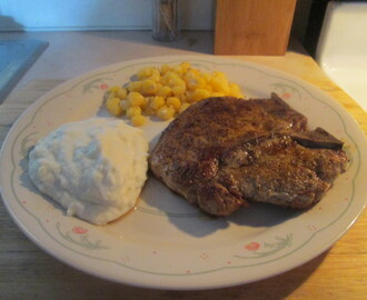 Cumin Spiced Pork Chop w/ Mashed Potatoes, Golden Hominy, and Baked Italian Loaf Bread