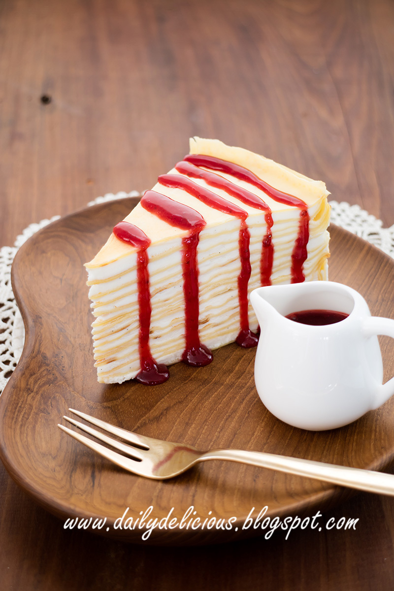 Crepe cake with berry sauce