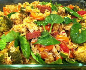 Chorizo, chicken and sweet potato baked rice with paprika, mixed veggies and spinach leaves