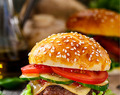Classic Beef Burger with Swiss Cheese Tomato and Cucumber
