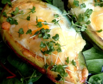 Avocado baked with egg and cheese - low in carbohydrates meal.