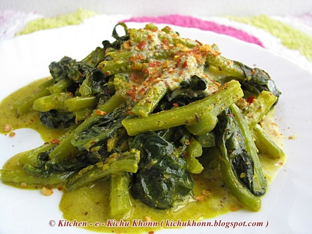 Pui shaak er daatar jhal or Stems of the Malabar spinach cooked in mustard gravy