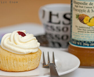 Mango and pineapple jam filled cupcake with cream cheese coconut frosting