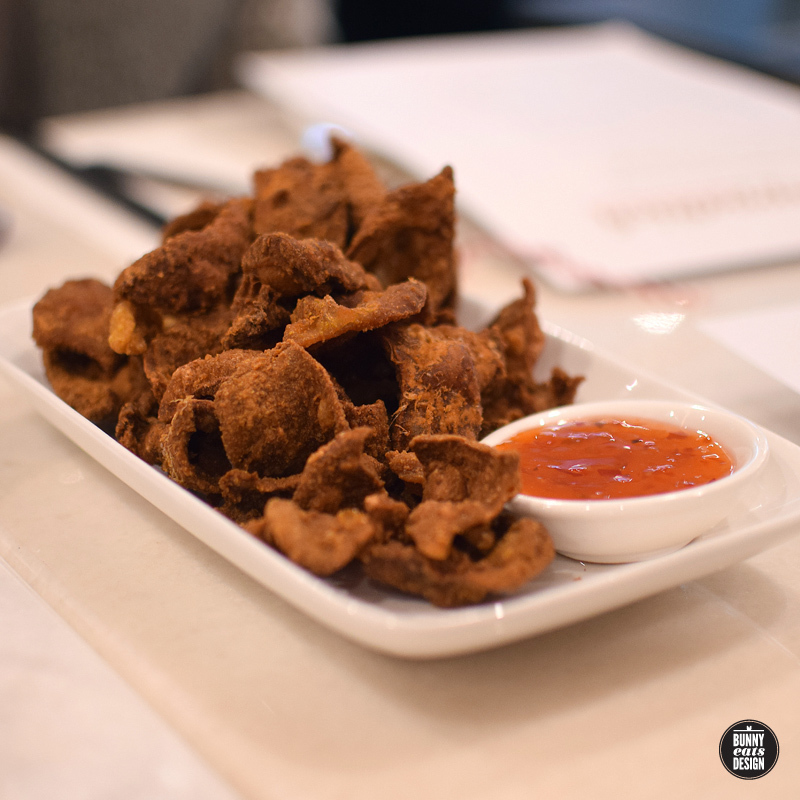 Crispy fried chicken skins and sweet drinks at PappaRich Auckland