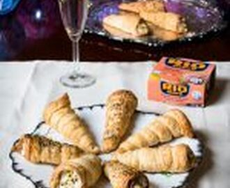 Puff pastry cannoli appetizers filled with tuna mousse