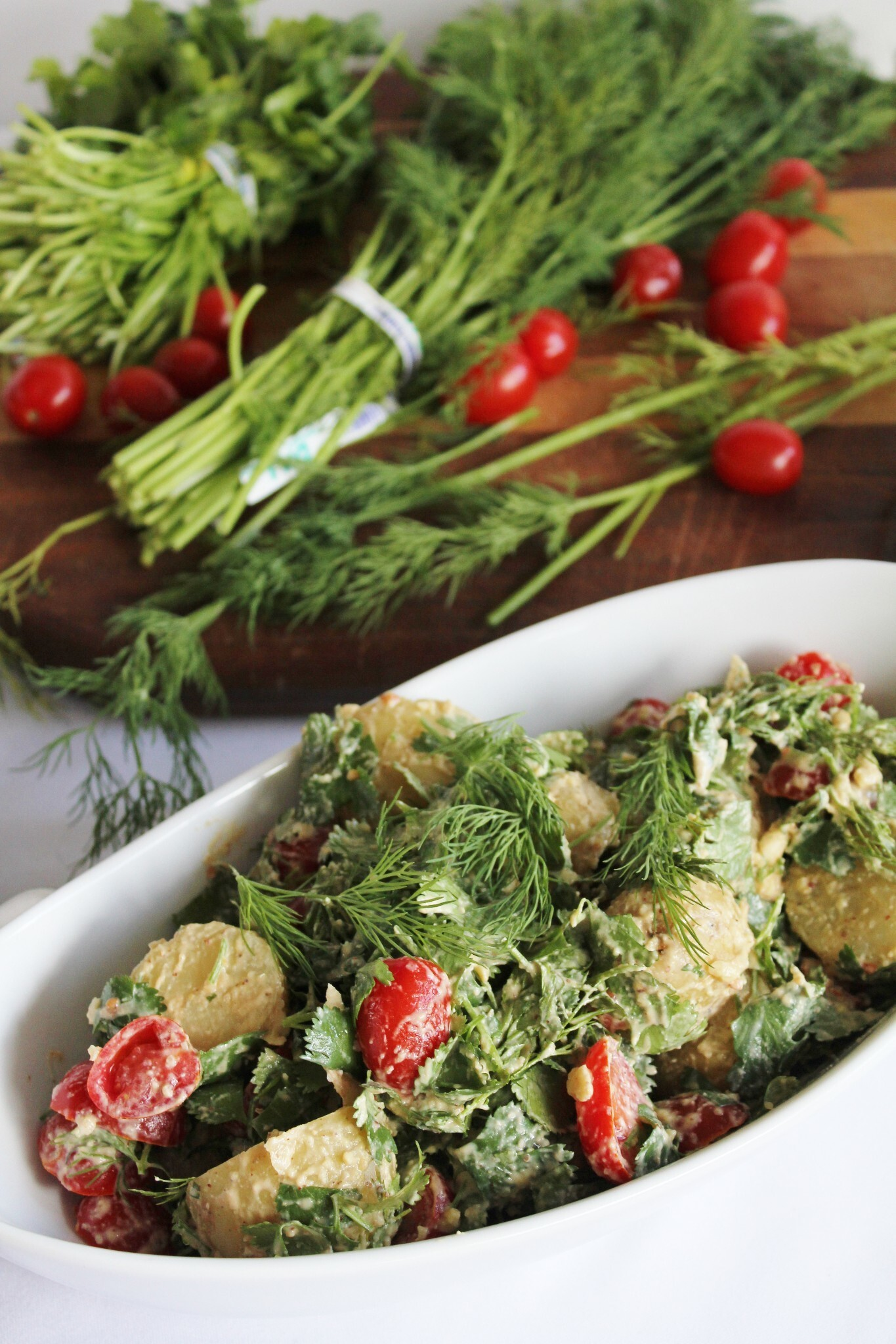 potato salad with cilantro, dill, tomatoes + raw mayo