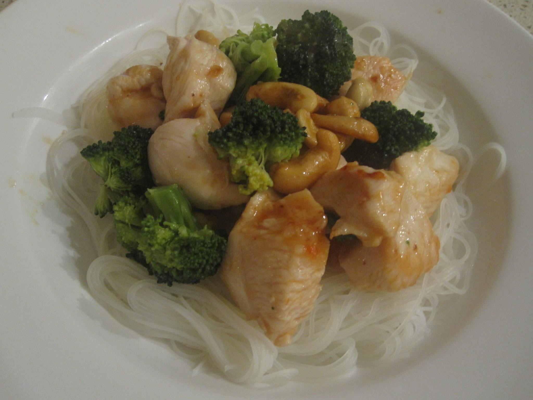 Chicken honey chilli with broccoli on vermicelli