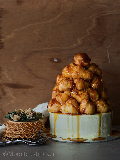 On her birthday/-/Pumpkin spiced Croquembouche on a caramel mud cake with Honey butter cream.
