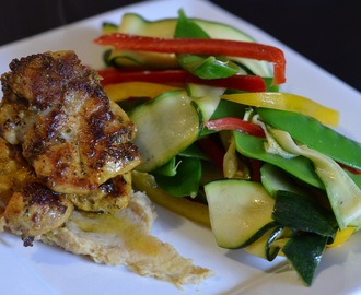 Spiced chicken thighs with chickpea mash and a zucchini, snow pea and capsicum salad