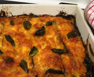 moussaka topped with basil and mozzarella