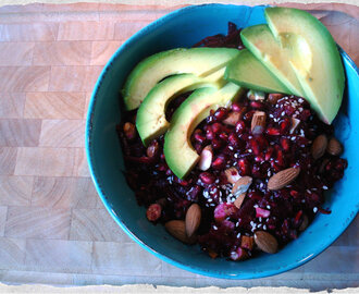 Healthy, crunchy beetroot salad with avocado, pomegranates and almonds