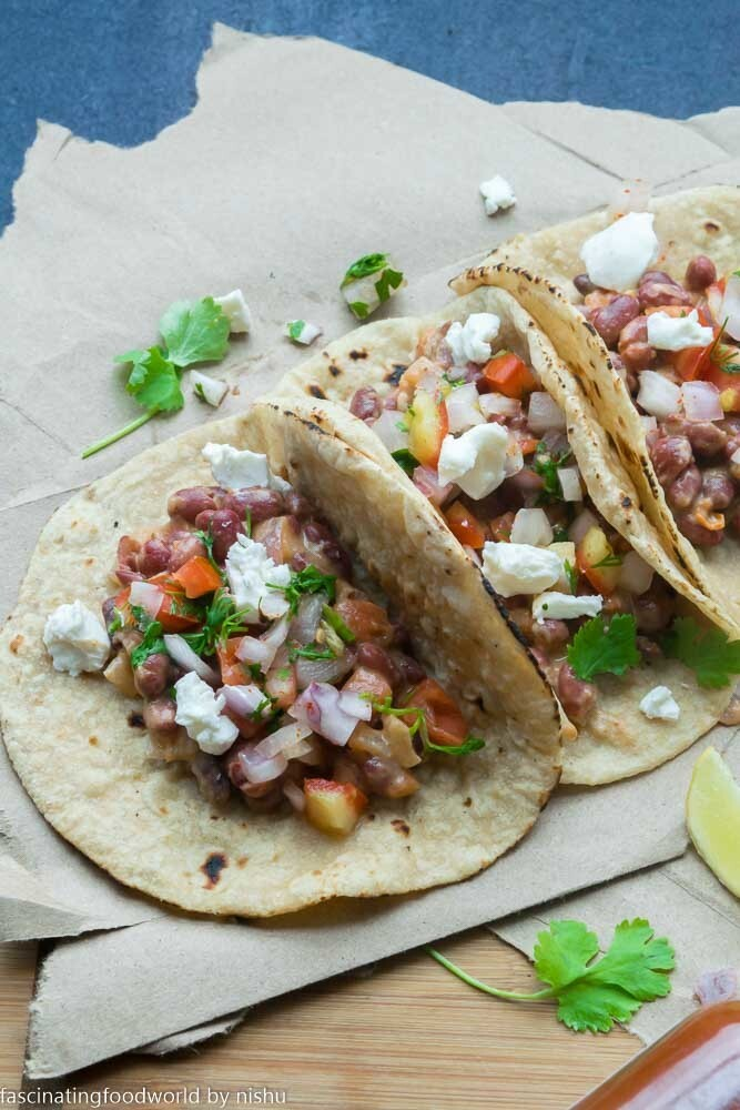 Mexican bean tacos with tomato-onion salsa