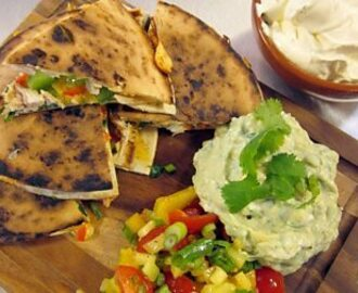 Chicken and cheese quesadillas with guacamole, sour cream and mango salsa