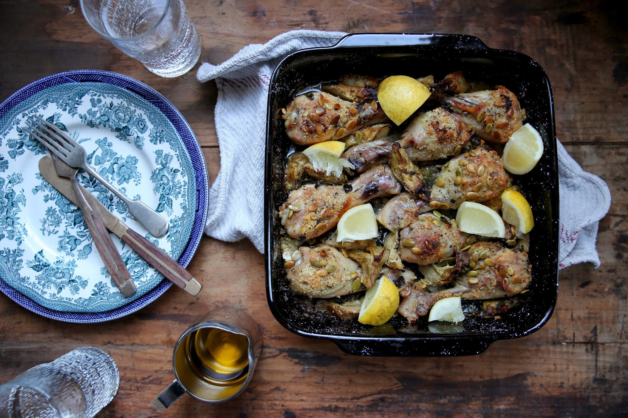 CRISPY ALMOND COATED CHICKEN ROASTED WITH ARTICHOKES & LEMON