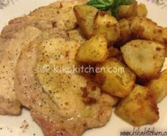 Scaloppine di arista con patate al forno croccanti