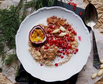 Christmas Porridge with Christmas Fruits like Passion Fruit and Pomegranate, and Raw Almond Butter