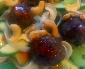 Asian style meatballs on a rice noodle salad