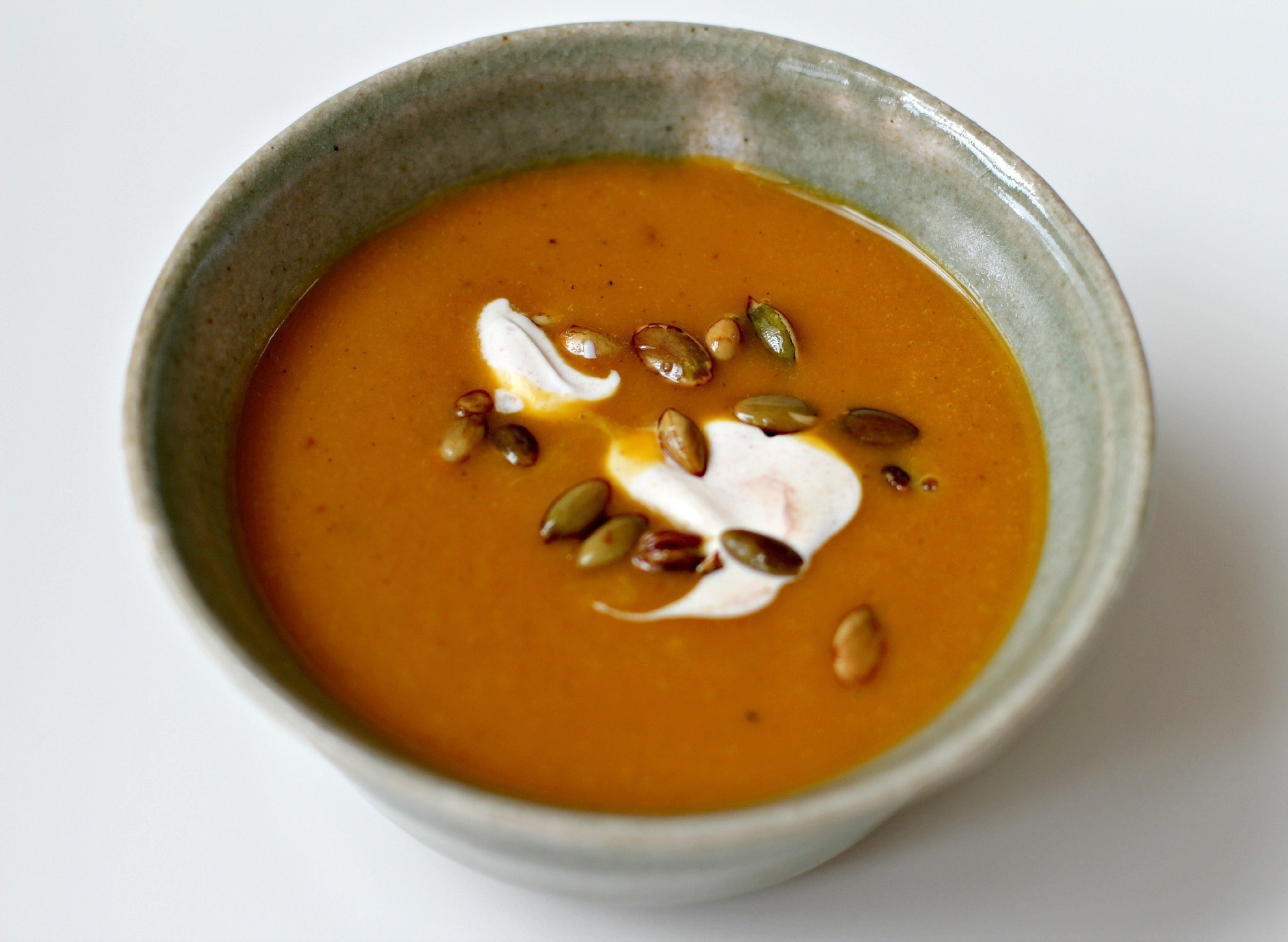 Roasted Pumpkin Soup with Cinnamon Creme Fraiche and Toasted Pumpkin Seeds