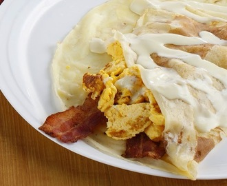 Breakfast Crepe with Egg Bacon and Cheese Sauce