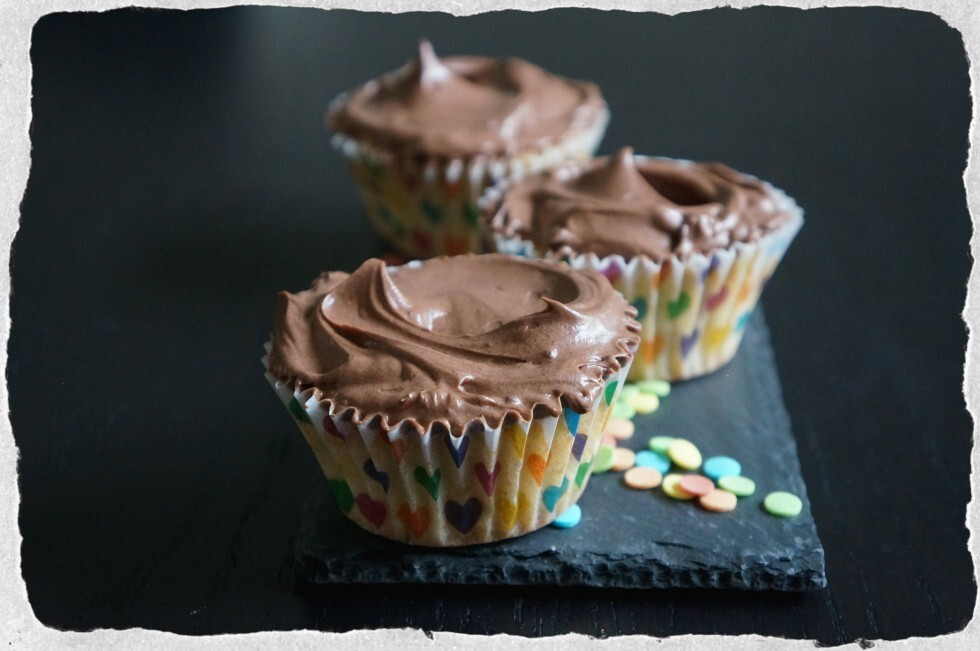 Vanilla cupcakes with cocoa cream cheese frosting