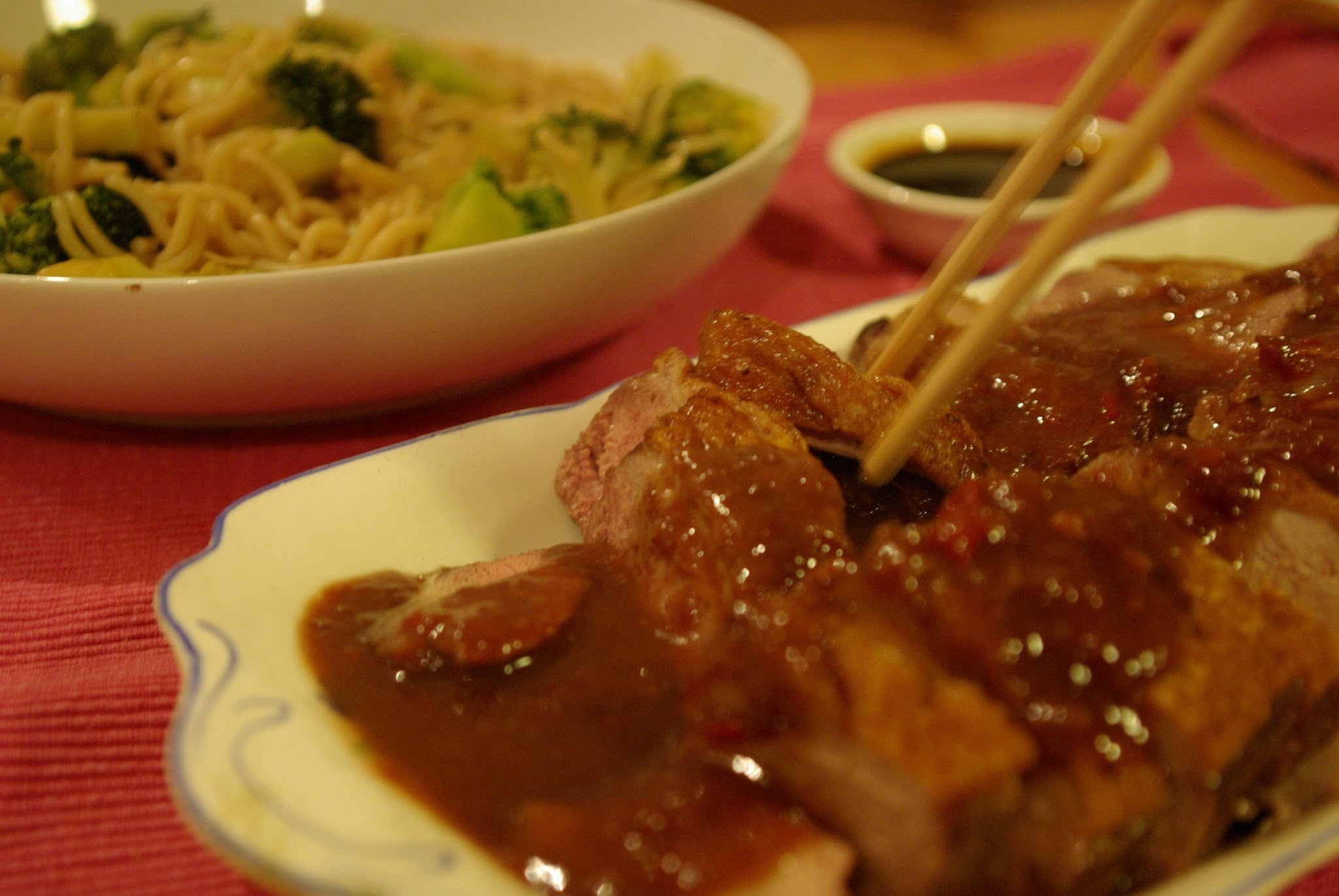 Duck in plum sauce and broccoli with noodles