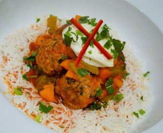 Middle Eastern meatballs baked in a tomato and vegetable sauce