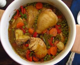 Stewed chicken with peas, carrot and peppers