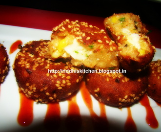 Tilwale Aloo Tikki ( Stuffed with cheese cube and coated with sesame seeds)
