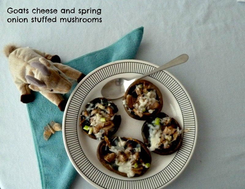 Goats' cheese, spring onion and garlic stuffed mushrooms
