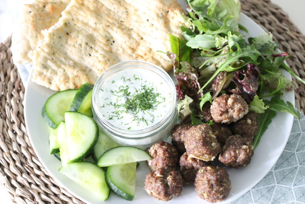 Homemade tzatziki with meatballs and flatbread