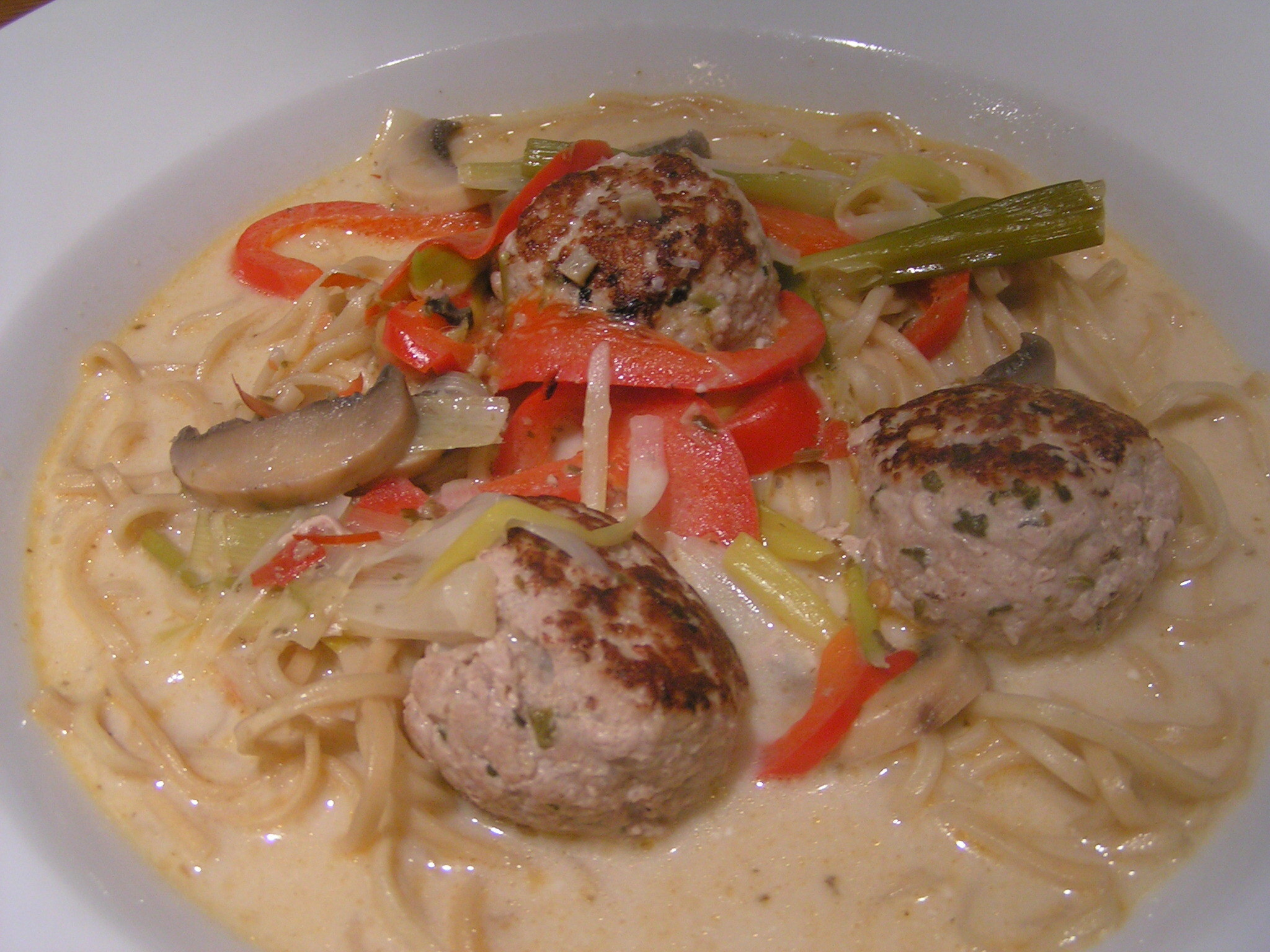 Thai noodle soup with pork patties