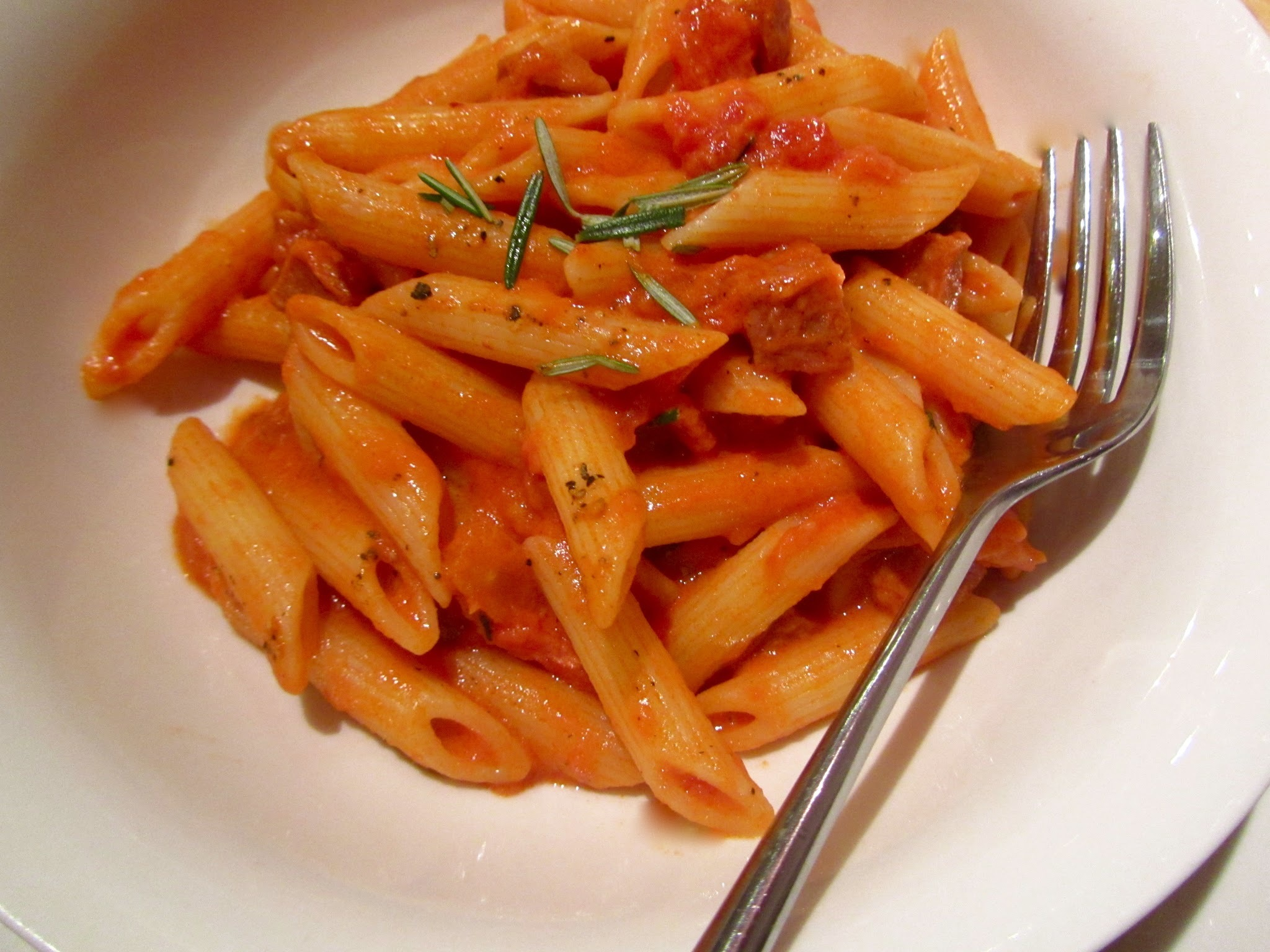Pasta with spicy sausage and rosemary sauce