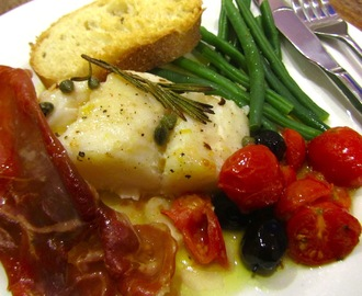 Roasted cod with prosciutto, cherry tomatoes and olives
