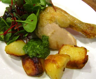 Roast chicken with roast potatoes and homemade basil pesto