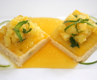 Polenta cakes with raisin and rum, braised pineapple and pineapple tartare with lime and mint