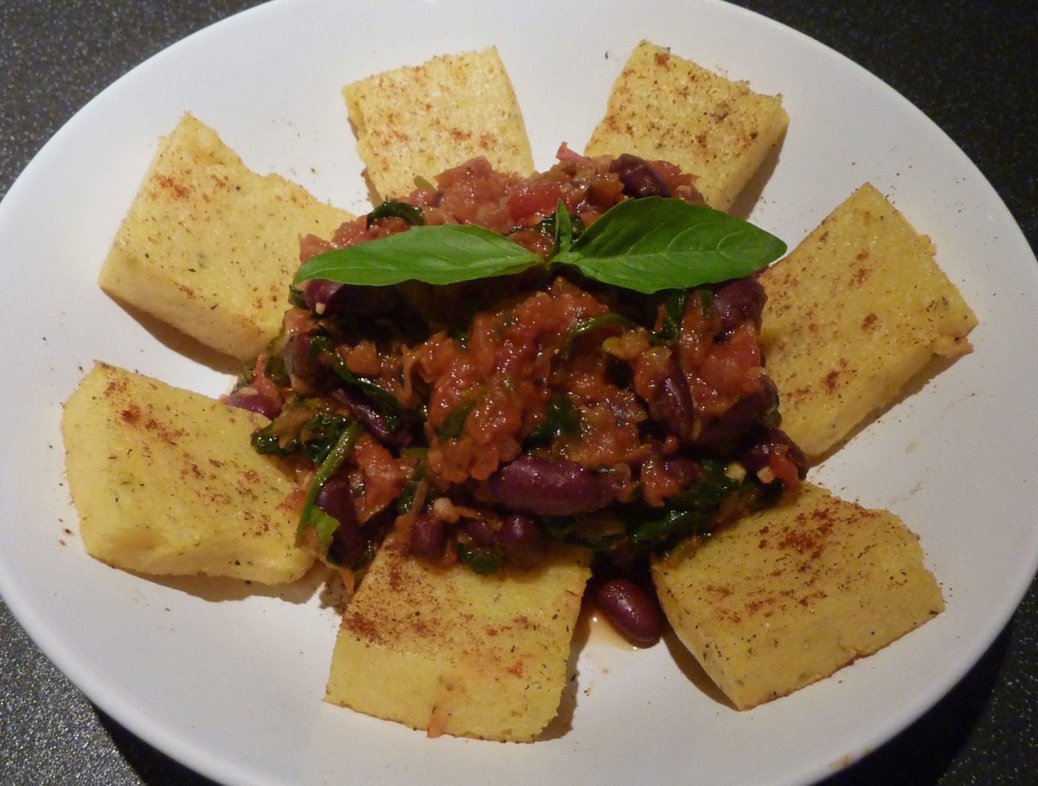 Spicy polenta with greens and beans
