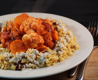 Roasted Cauliflower & Chickpea Tagine served with saffron spiced cashew & cranberry bulgur wheat and a minted tahini dressing