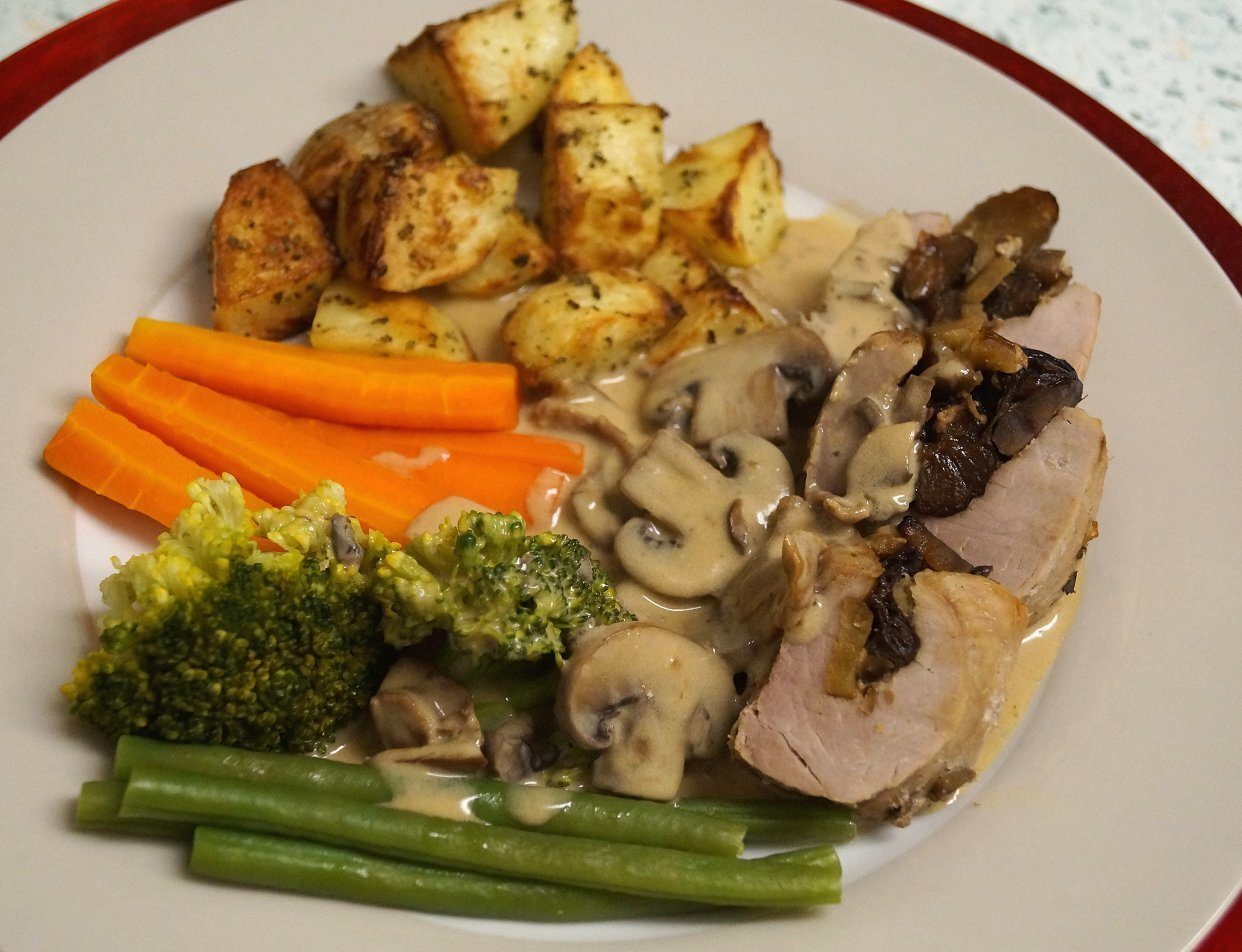 Pork tenderloin stuffed with sherry soaked prunes and chestnuts, in a mushroom cream sauce.
