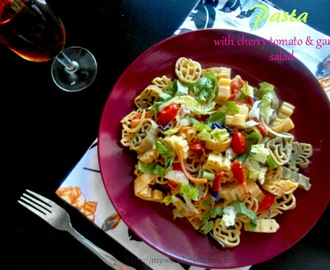 Pasta made with cherry tomatoes ,garden salad ,sour cream & cheese