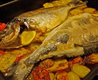 Roasted whole sea bream (dorade) with potatoes and tomatoes