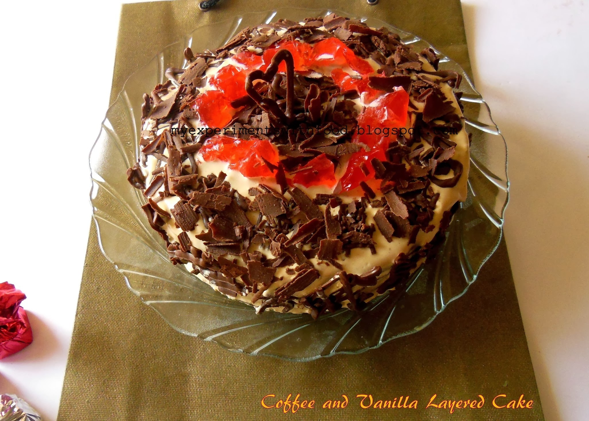 Vanilla and Coffee layered Cake with Coffee Cream Frosting and Chocolate Decorations