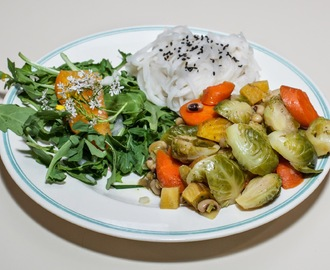 Brussels Sprouts with Black-Eyed Peas, Carrot, and Baby Golden Beet, served with Brown Rice Noodles and a Salad of Heirloom Tomato atop Baby Arugula, garnished with Cilantro Flowers